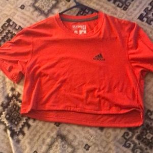 A hot orange / pink crop top from adidas